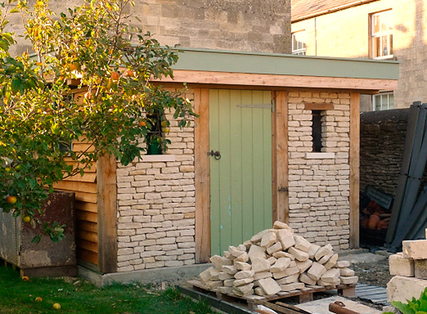 Stone shed made from recycled local stone and waste materials