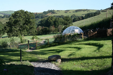 Beautiful ampitheatre for children's plays and geodesic green house dome beyond