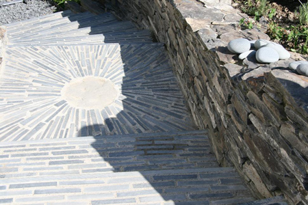 Circular elegant slate patterns in paving by local craftsmen